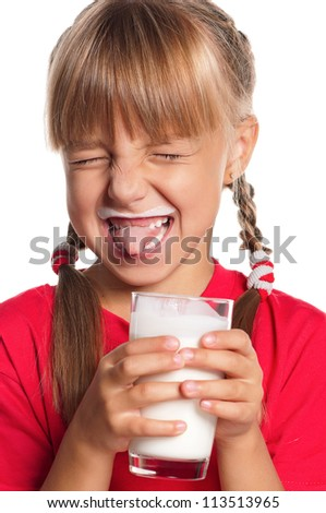 Little girl with a glass of milk on white background - stock photo