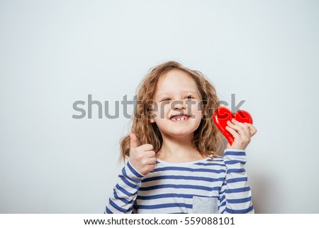 little girl with a heart