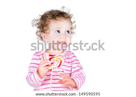 Little girl with a heart shaped candy, isolated on white