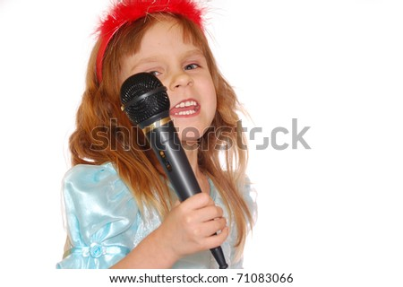 little girl with a microphone singing karaoke