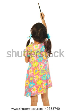 Little girl with a paintbrush - stock photo