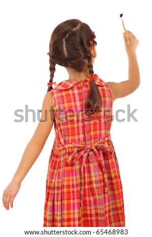 Little girl with a paintbrush, rear view, isolated on white