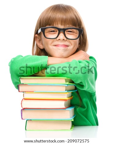 Little girl with a pile of books, isolated over white - stock photo