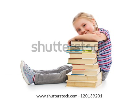 Little girl with a pile of books. Studio shot on white background. - stock photo