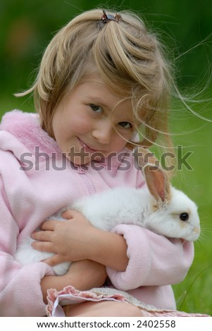 little girl with a rabbit - stock photo