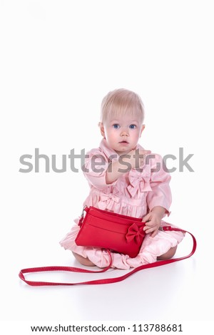 Little girl with a red handbag in her hand