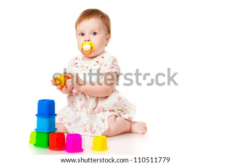 Little girl with a toys, isolated on white - stock photo