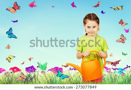 Little girl with a watering can against the bright nature background - stock photo