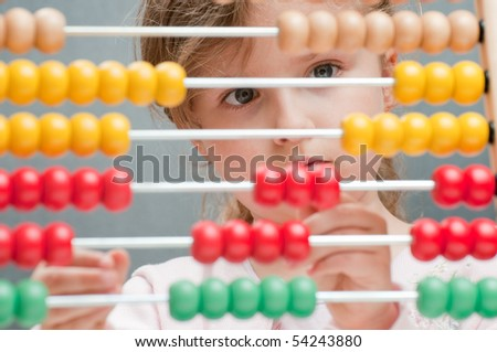 Little girl with abacus - stock photo
