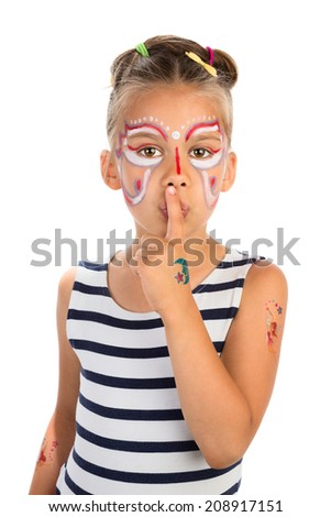 Little girl with abstract face painting holding an index finger against her lips, isolated - stock photo