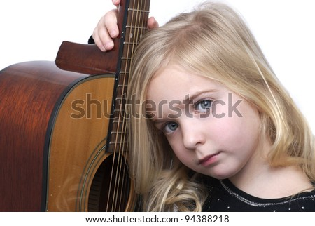 little girl with acoustic guitar - stock photo