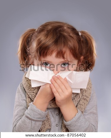 Little girl with allergy or cold - stock photo