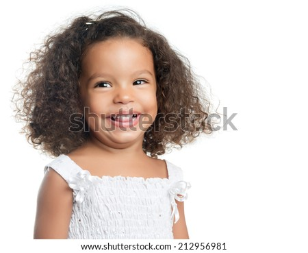 Little girl with an afro hairstyle smiling and wearing a white dress isolated on white - stock photo