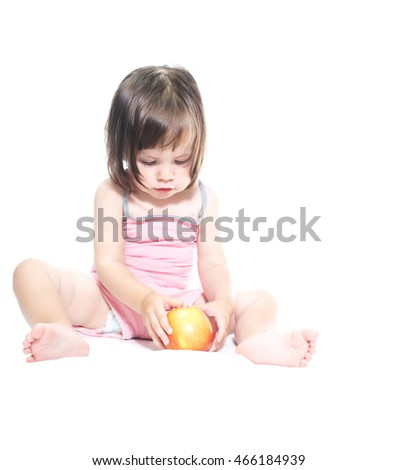 Little girl with apple. Isolated on white background