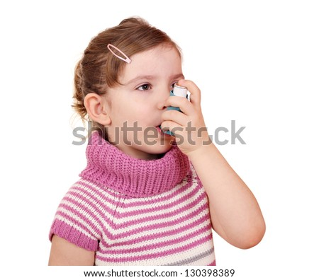 little girl with asthma inhaler - stock photo