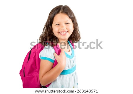 Little girl with backpack on her way to school - stock photo