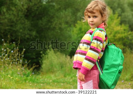 little girl with backpack outdoor in summer - stock photo
