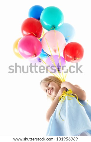 Little girl with balloons - stock photo