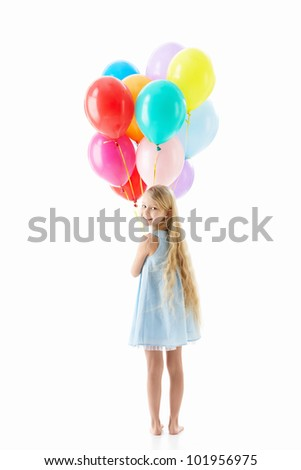 Little girl with balloons isolated - stock photo