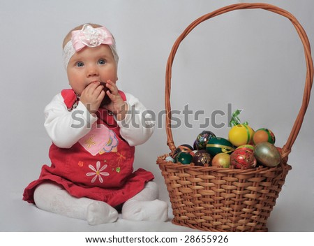 little girl with basket and Easter eggs - stock photo