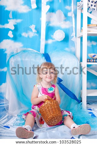 Little girl with basket of apples - stock photo