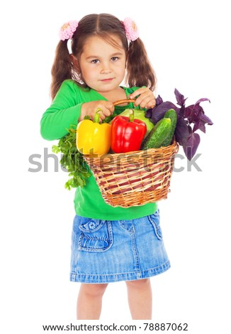 Little girl with basket of vegetables, isolated on white - stock photo