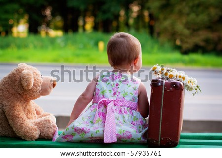 little girl with bear and luggage - stock photo