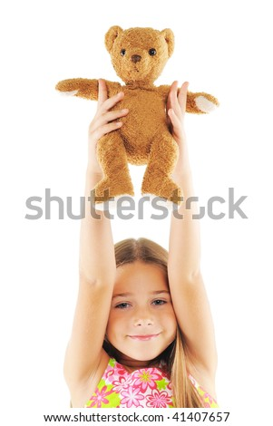 Little girl with bear toy. On white background - stock photo