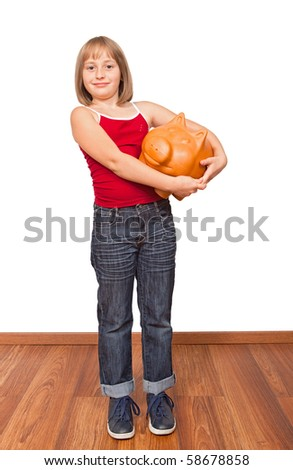 Little girl with big fat piggy bank, proud on savings - stock photo
