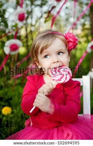 little girl with big lollipop - stock photo