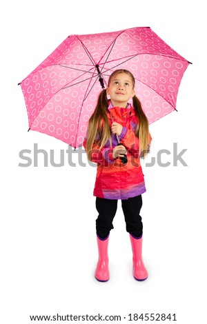 Little girl with big pink umbrella