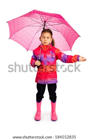 Little girl with big pink umbrella checking if it's still raining - stock photo