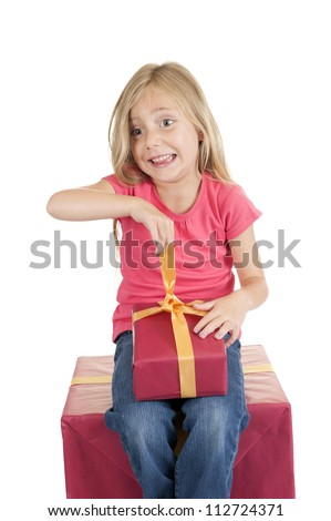 little girl with birthday presents, isolated on white background - stock photo