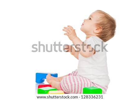 Little girl with blocks, isolated on white