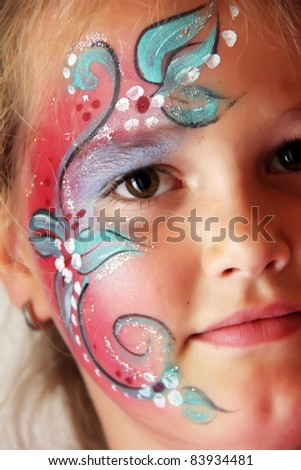 little girl with body painted flower face - stock photo