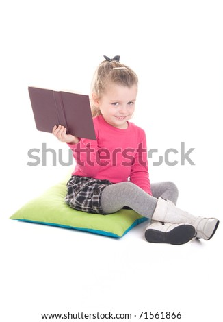 Little girl with book, isolated on white background - stock photo