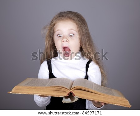 Little girl with book. Studio shot. - stock photo