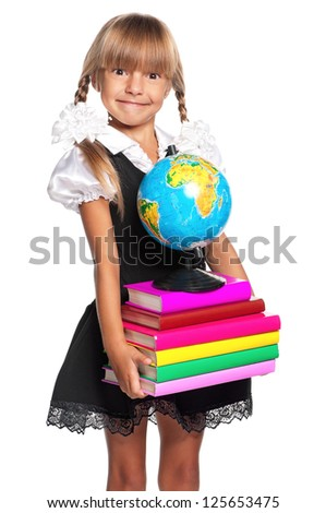 Little girl with books and globe of the world isolated on white background