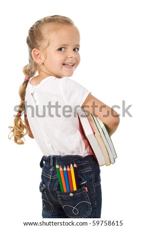 Little girl with books and pencils prepared to go back to school - isolated - stock photo