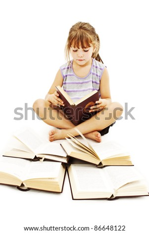 Little girl with books on the floor.  Isolated on white background