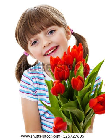 little girl with bunch of red tulips - stock photo