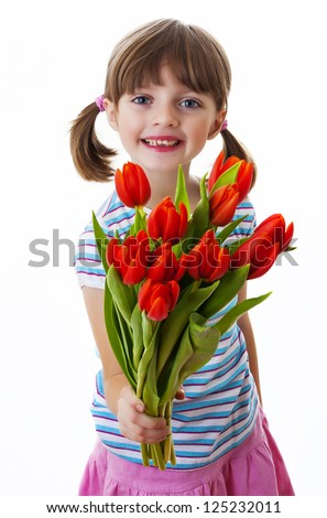 little girl with bunch of red tulips - mothers day concept - stock photo