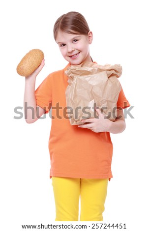 little girl with buns/little girl offers tasty bun isolated over white - stock photo