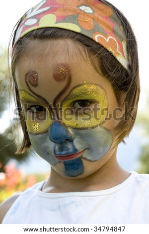 Little girl with butterfly make-up having fun