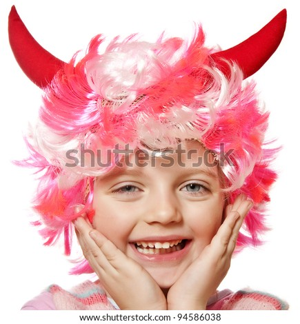 little girl with carnival or halloween mask - stock photo