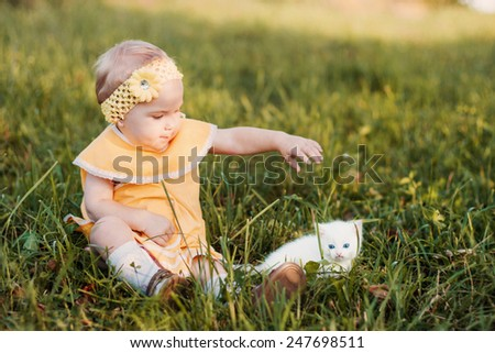 little girl with cat - stock photo