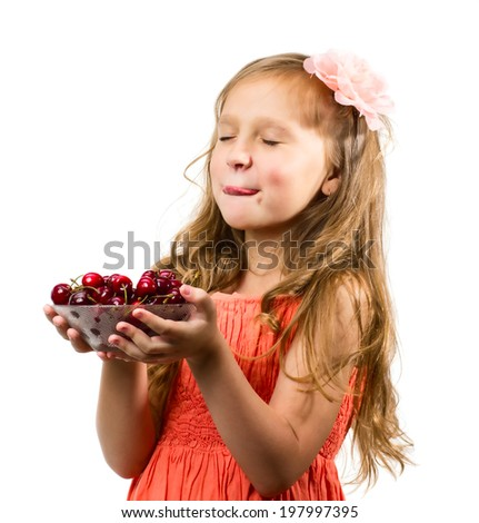 Little girl with cherries isolated on white background - stock photo