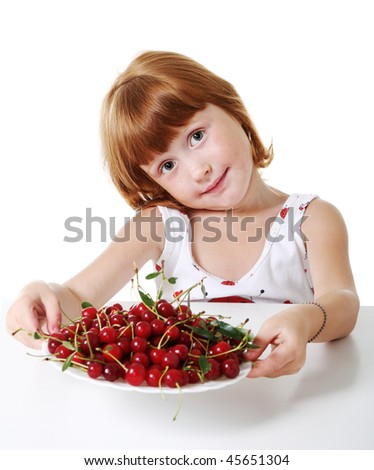 Little girl with cherry - stock photo