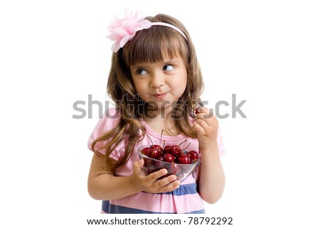 little girl with cherry berries bowl in studio isolated - stock photo