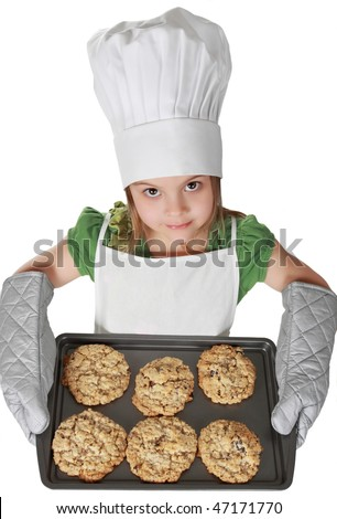 little girl with chief hat holding a cookie sheet, isolated on white - stock photo